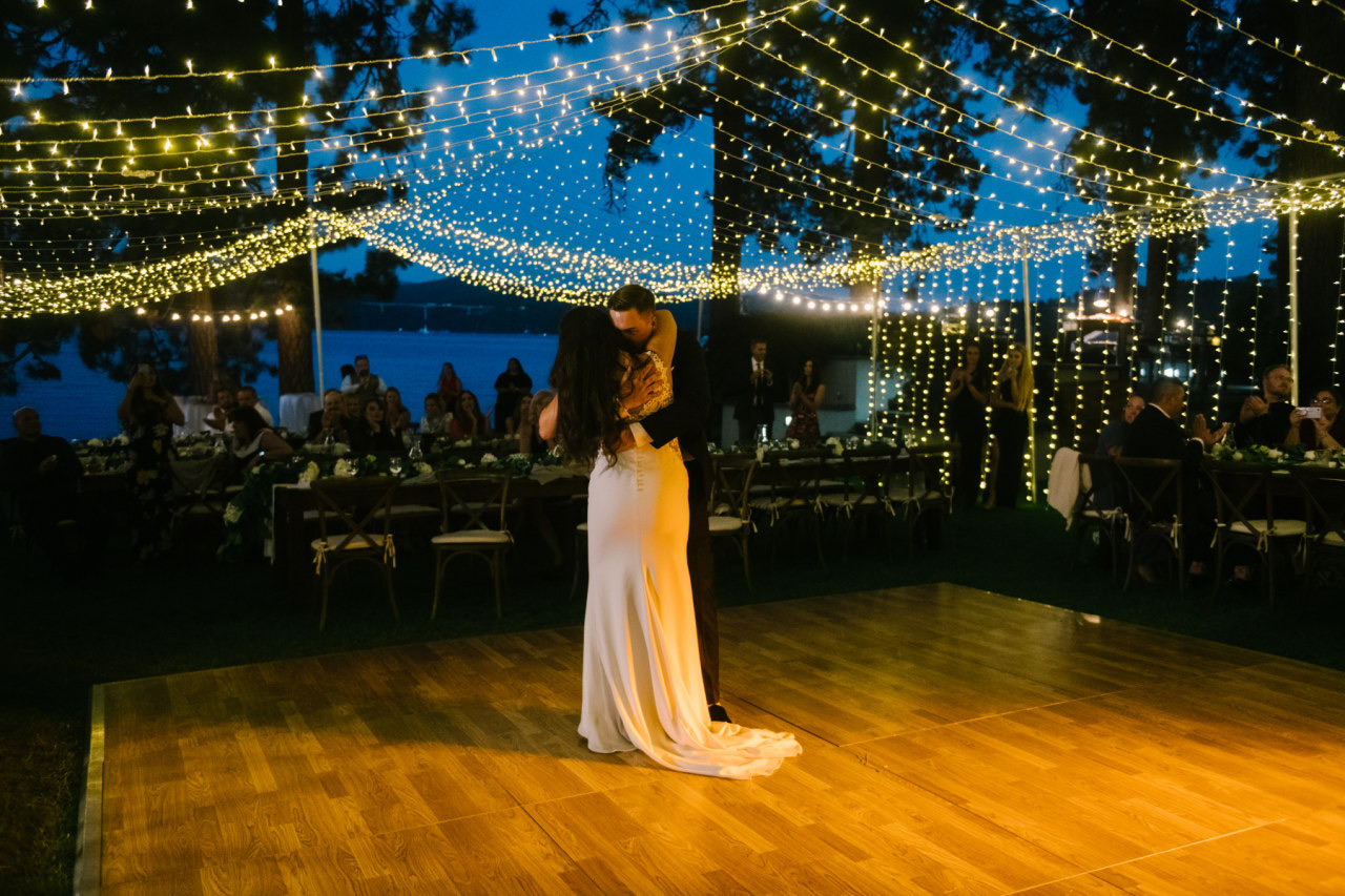 wedding, bride and groom, first dance, Ashley graham events, Mangia Catering, by the lake venue, dance floor, twinkle lights, romantic